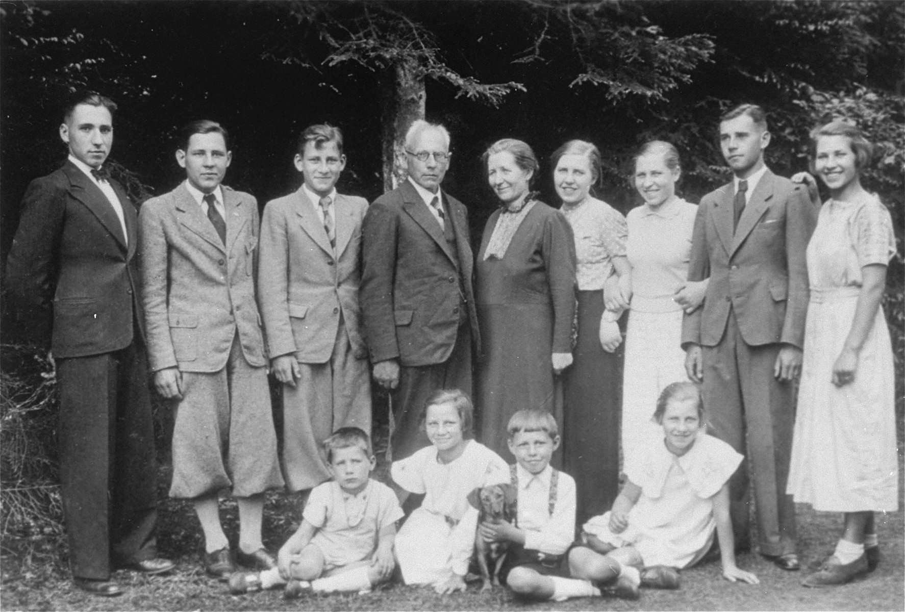 The last photo of the entire Kusserow family.    Pictured standing from left to right are Siegfried, Karl-Heinz, Wolfgang, Franz, Hilda, Annemarie, Waltraud, Wilhelm, and Hildegard.  Seated are Paul-Gerhard, Magdalena, Hans-Werner, and Elisabeth.