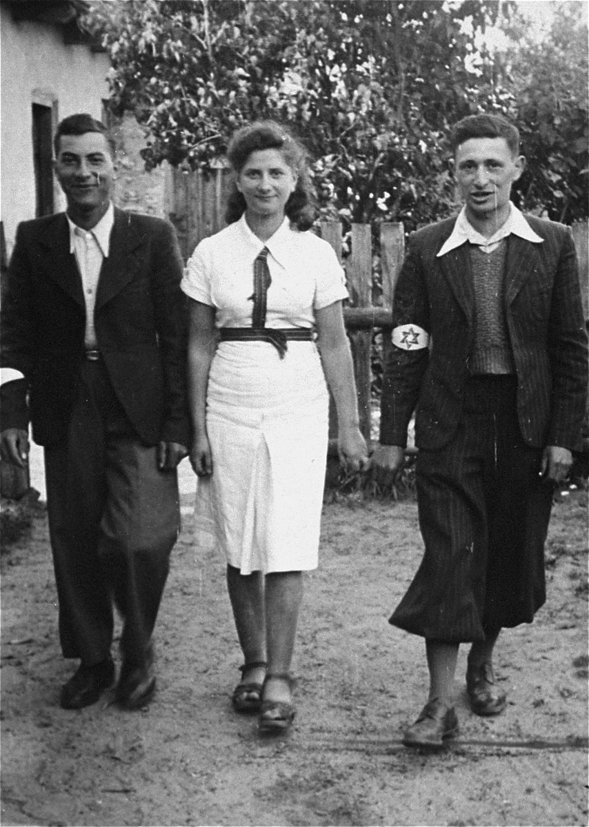 Three members of the Hashomer Hatzair Zionist collective on their farm in Zarki.  Pictured from left to right are: Motek Weinryb, Lodzia Hamersztajn and Berel Lemel.