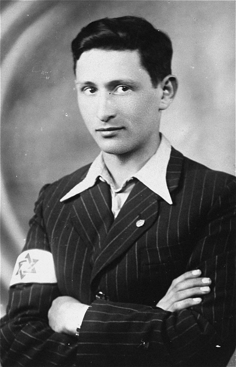 Portrait of Berel Lemel wearing a Jewish armband.  Berel Lemel was a member of the Hashomer Hatzair in Zarki, who became involved with the agricultural collective established by fellow movement members from Warsaw.  He was later killed by Polish partisans.