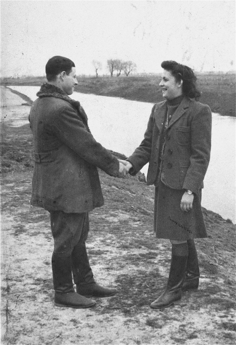 Two Jewish cousins greet one another upon their return to their hometown of Wlodawa after the war.  Pictured are Sruel Bajtelman and Rachel Ejber.