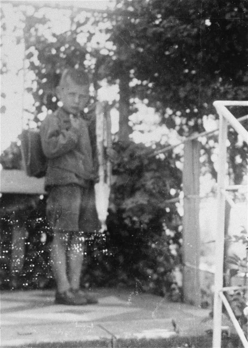 Paul-Gerhard Kusserow with a knapsack behind the family home in Bad Lippspringe.    The Kusserow children used this knapsack to remove religious literature from the house and hide it in the garden when warnings of impending Gestapo searches were received.  In this way the family was able to hide their literature through 18 searches by the Gestapo from 1933 to 1945.
