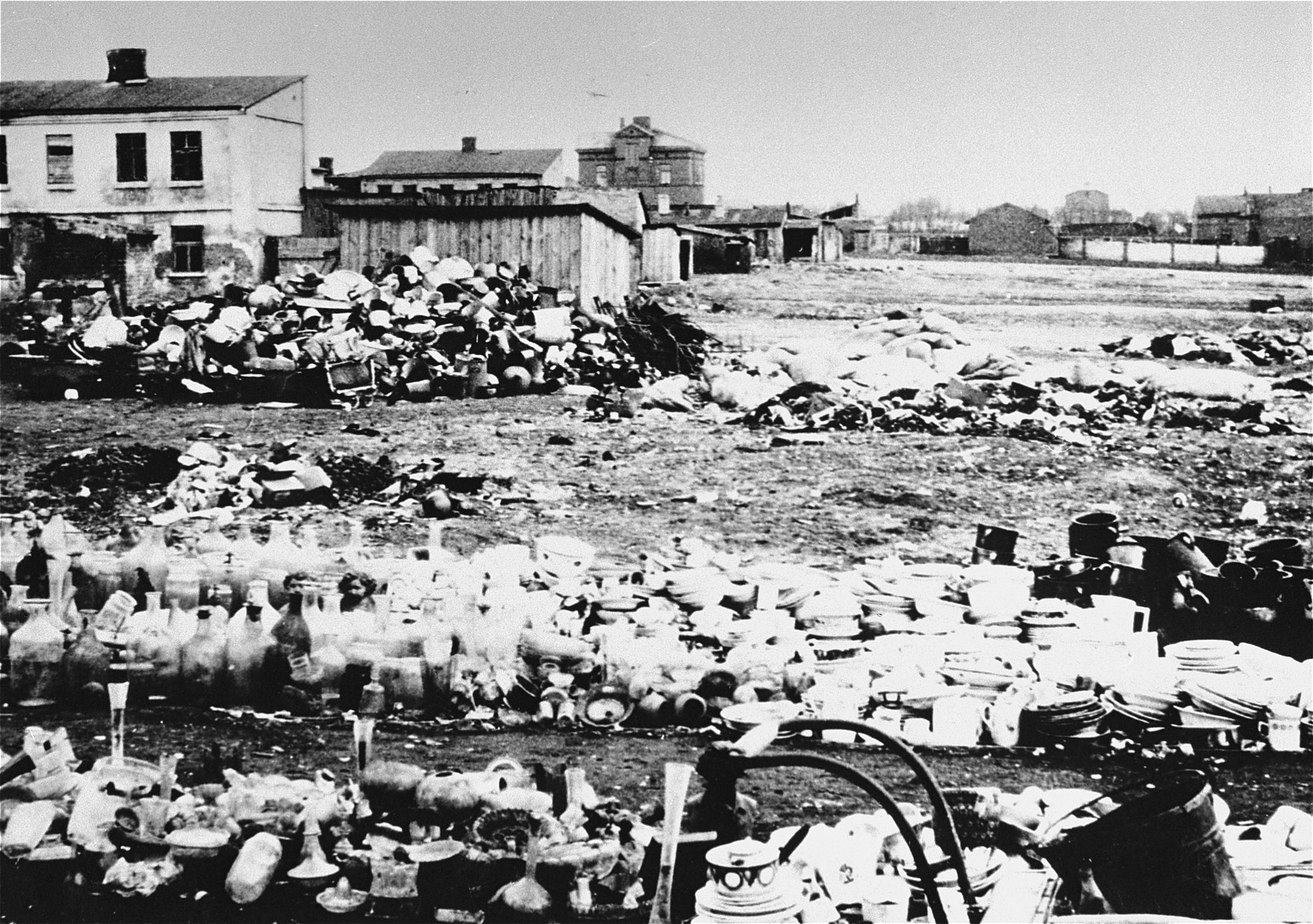 The abandoned property of Jews who have been deported from the Zychlin ghetto is piled in an open field.