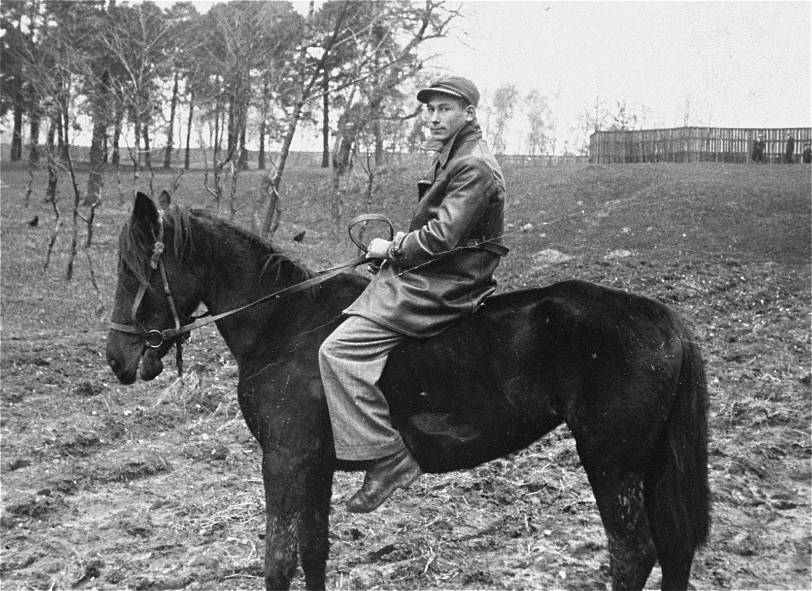 Amnon Klukowski, a member of the Hashomer Hatzair Zionist collective, rides the only horse on their farm in Zarki.
