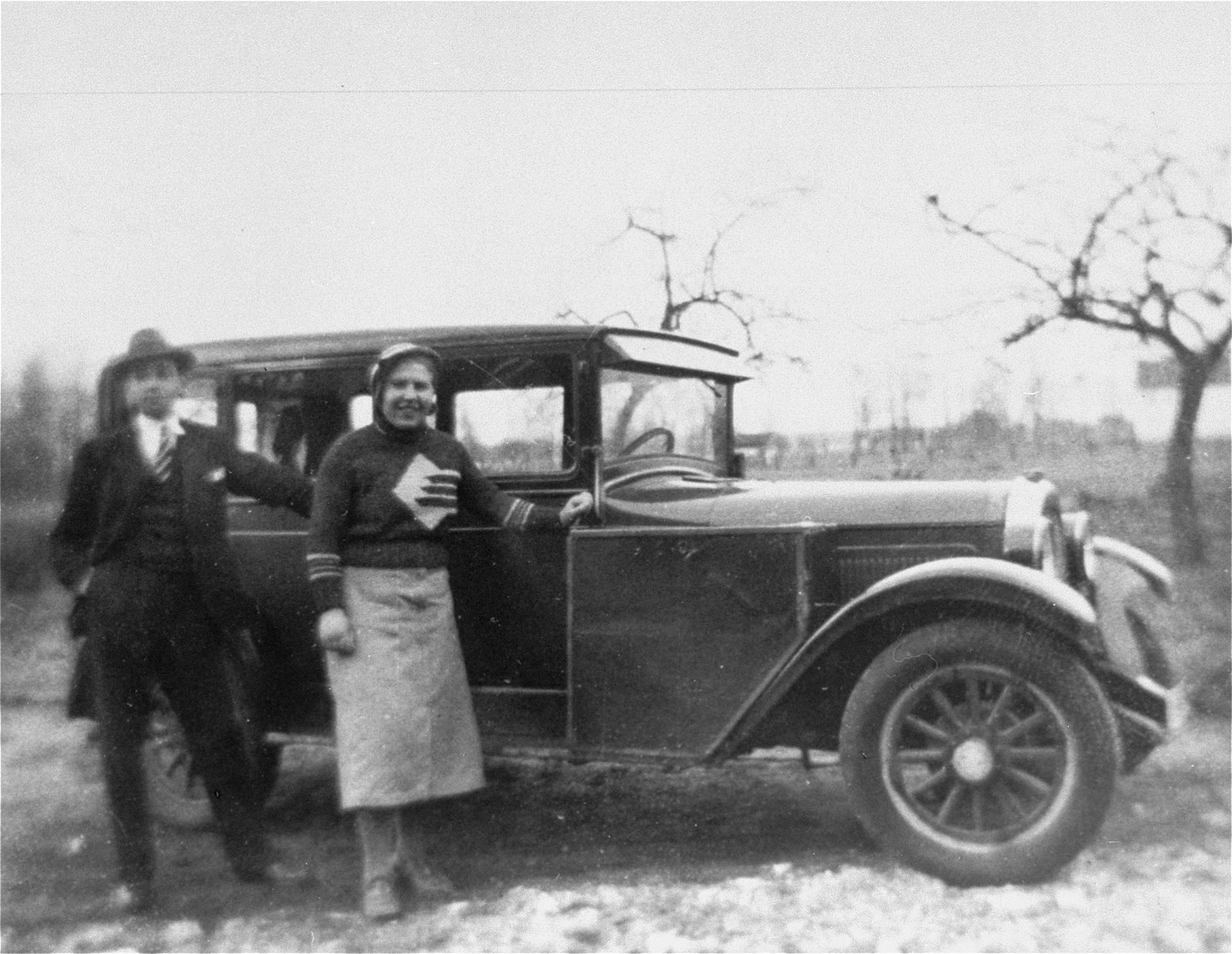 Wilhelm and Annemarie Kusserow with the family car in Bad Lippspringe.  The Kusserow's used the vehicle to distribute religious literature.