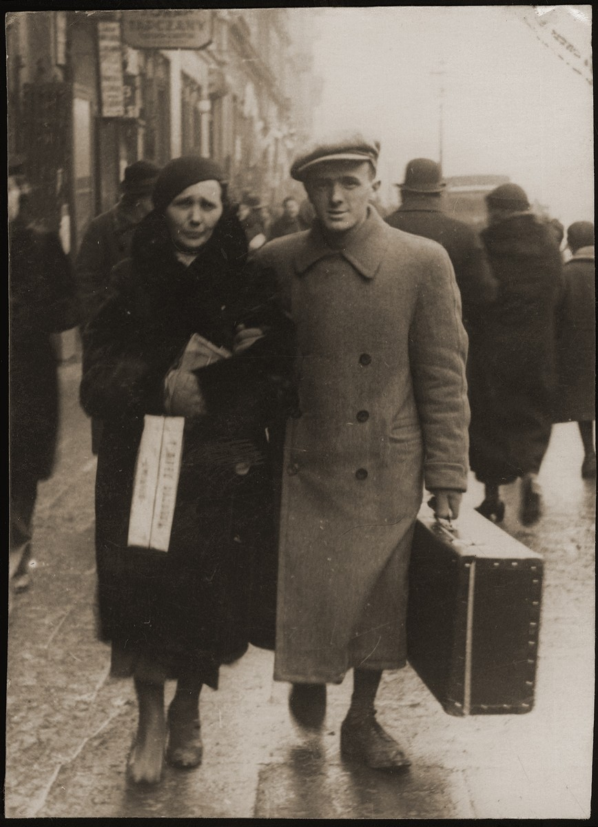 Suitcase in hand, Meir Orkin walks with his mother, Leiba, to the Bialystok train station, whence he will be departing for Palestine.