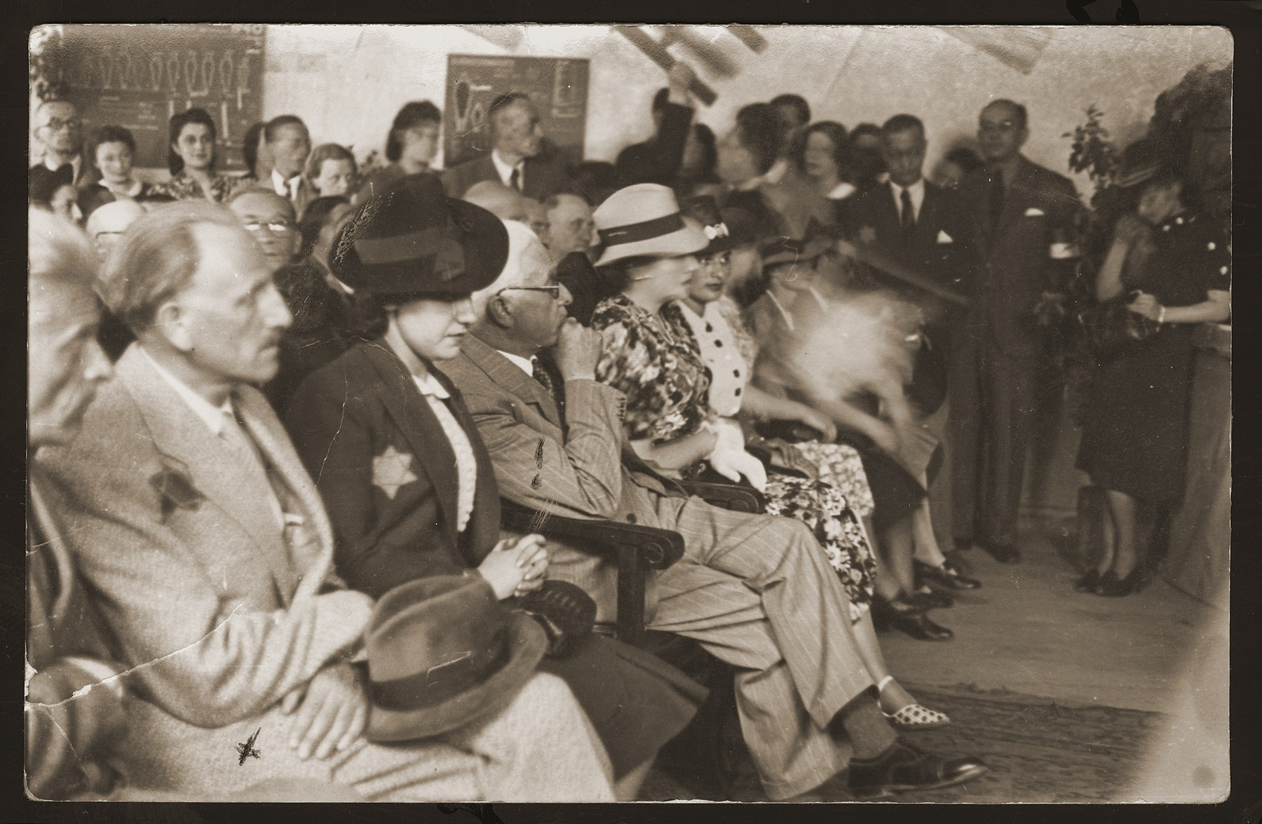 Jewish council chairman Mordechai Chaim Rumkowski (fourth from the left), attends a ceremony in the Lodz ghetto.    Also pictured are Dora Fuks (third from the left) and Dr. Michal Eliasberg (second from the left).