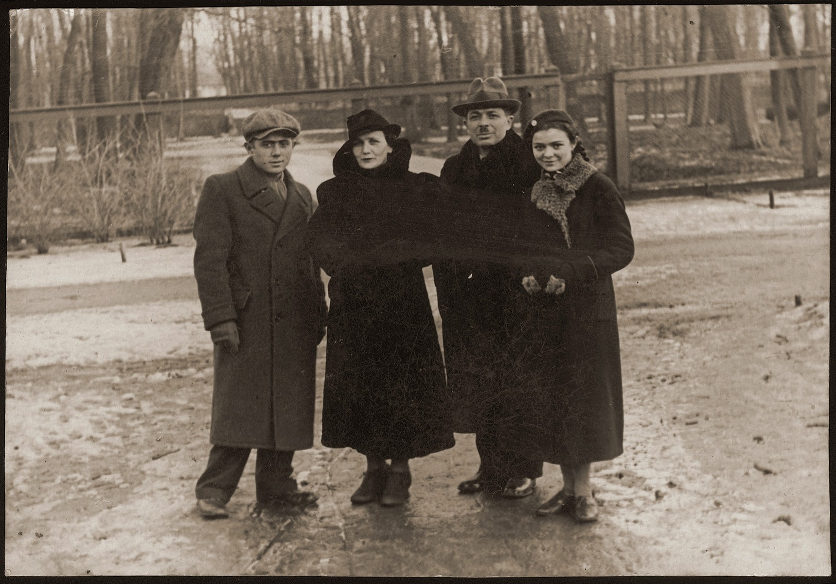 Members of the Orkin family pose outside.  Pictured from left to right are: Meir, Leiba, Kalman and Malka Orkin.