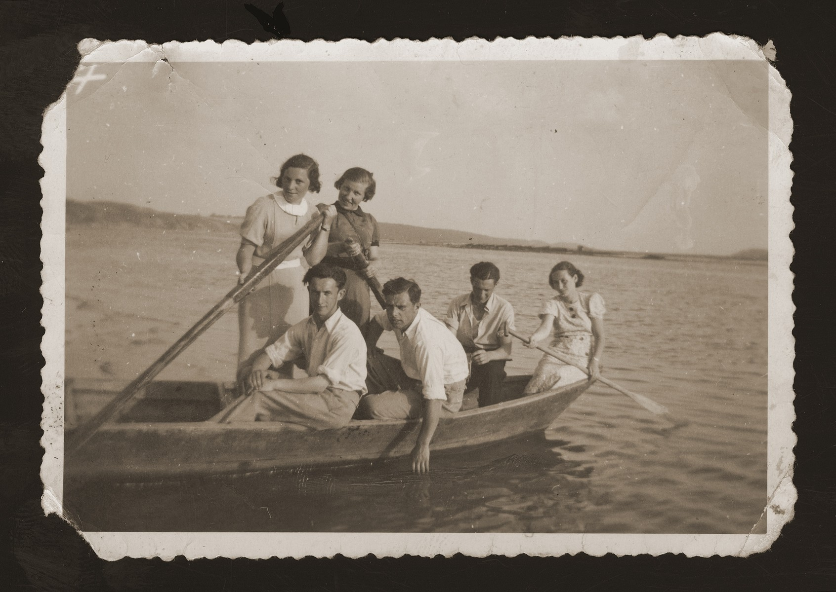 A group of Jewish friends go boating on the Nemunas River in the village of Vilkija near Kaunas.    Among those pictured are Dita Katz (far right) and Shimon Tamshe (second on the right).