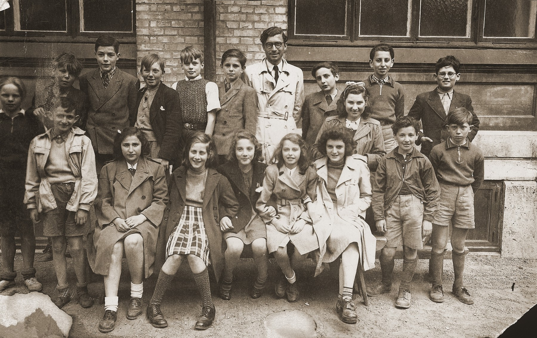 Students and teachers in a school for Danish refugees in Goteborg, Sweden.    The students were both Jewish and non-Jewish children of Danish members of the resistance.  Many of the teachers were themselves refugees.  Seated in the front left is Annie Block and second from the right is Kathe Hanover.  Standing second from the right, front row is Gus Goldberger and second from the right, back row is Leon Elkanowitz.