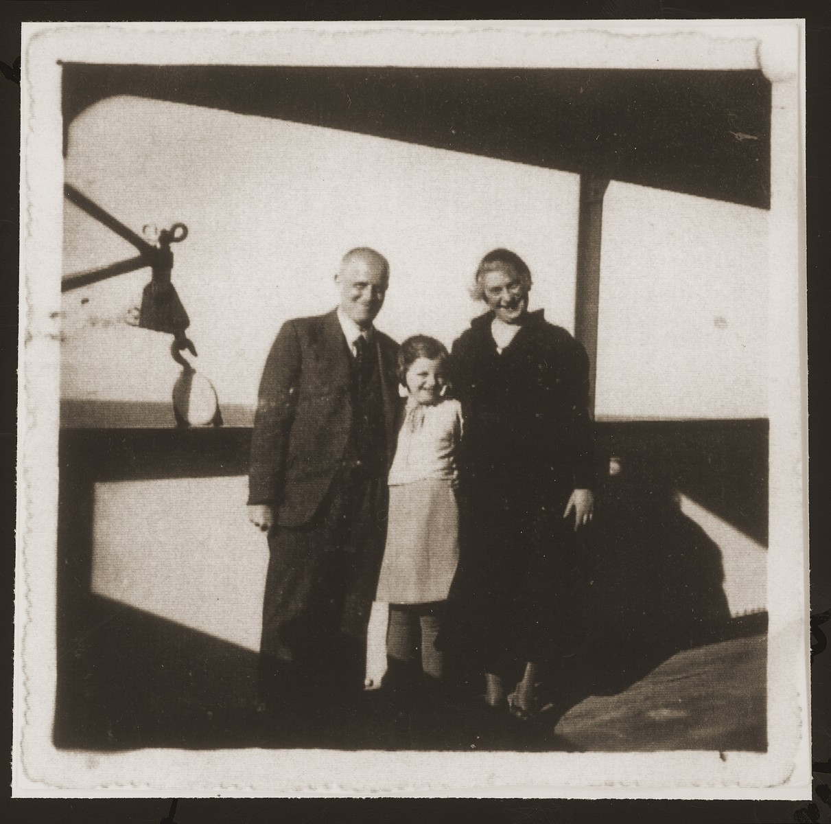 "The Mansbacher family on route to Shanghai on board the Norwegian freighter ""Triton"".  From left to right are Julius, Hannelore, and Kaethe."
