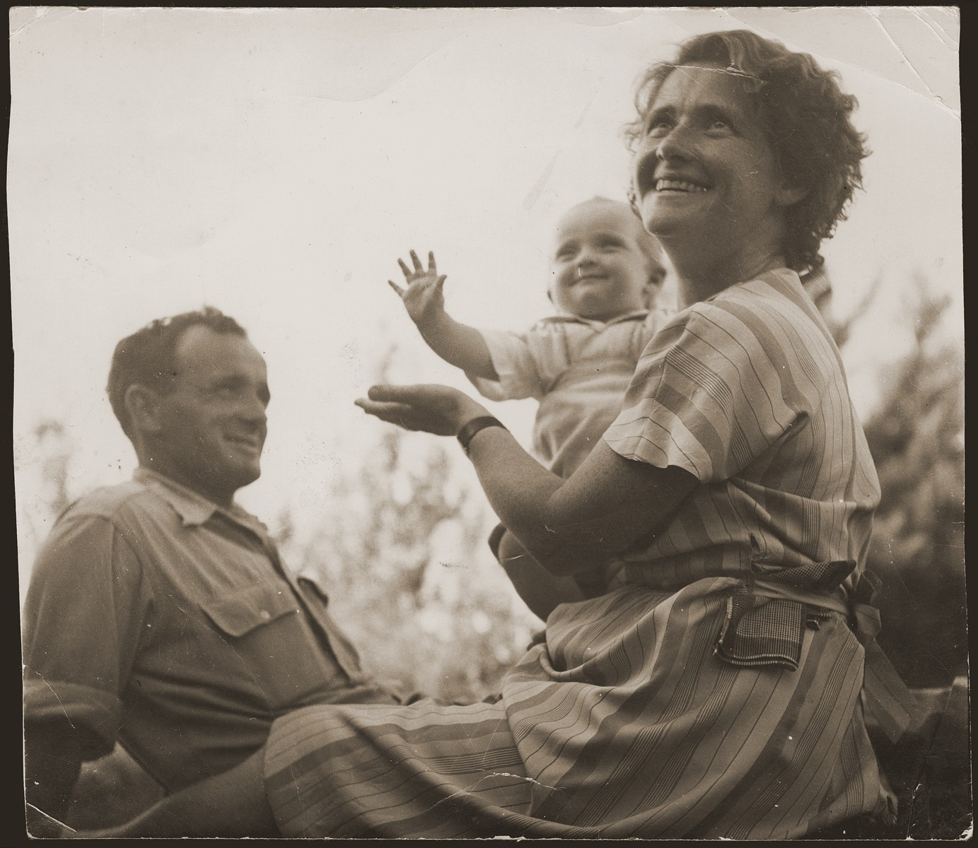 Haika Grosman relaxes with her husband, Meir Orkin, and daughter, Leah, on Kibbutz Evron.