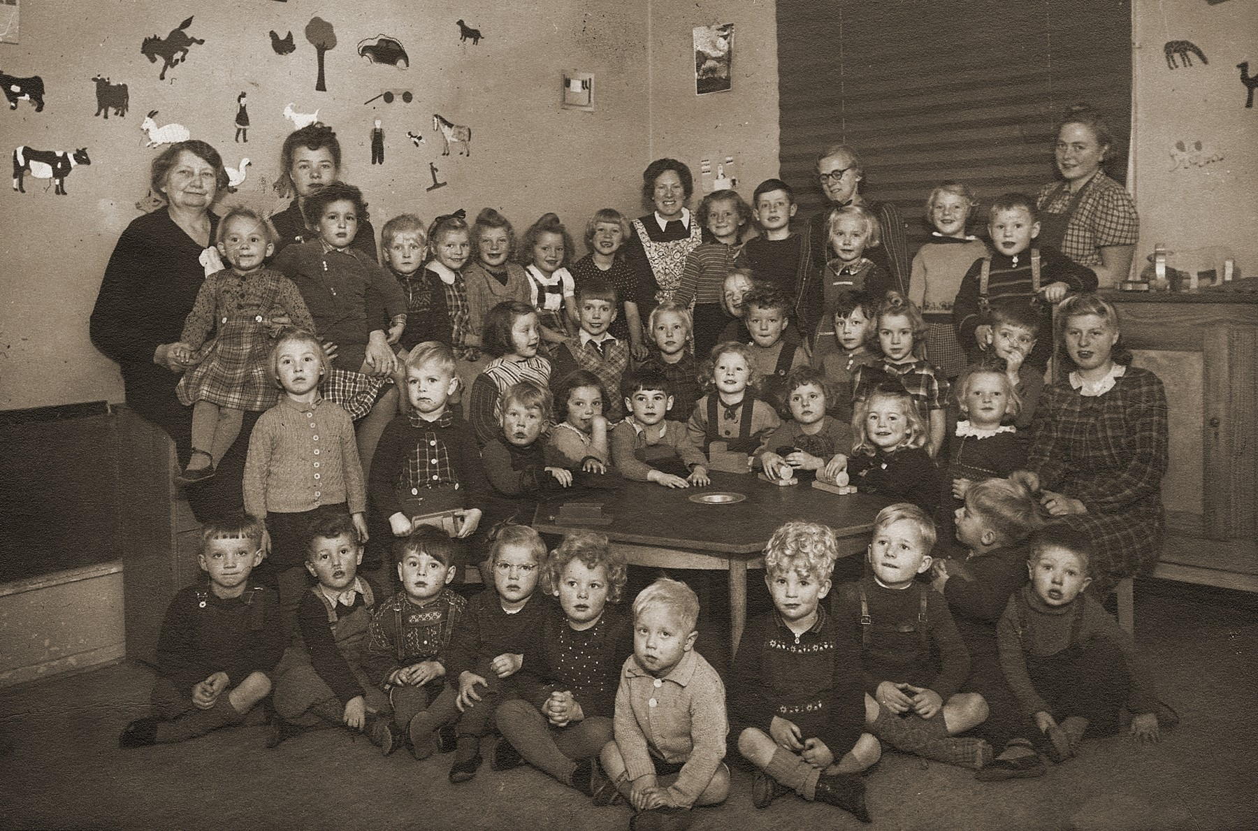 Class portrait of teachers and pupils at a preschool in Copenhagen.  Among those pictured is Gus Goldberger (top row, second from the left), one of the only Jewish children in the class.