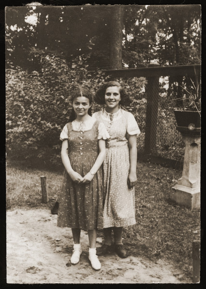 Two Jewish girlfriends pose in a park in Bialystok.  Pictured are Malka Orkin (left) and her friend Tusia Goldberg.  Tusia, whose father later became a member of the Bialystok ghetto Jewish council, survived the war.