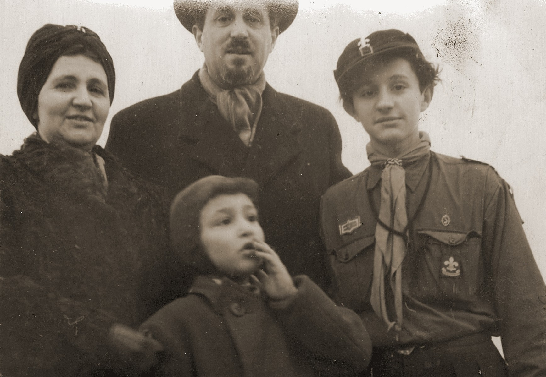 Eugene and Helen Goldberger with their sons Leo and Gus.  Leo is wearing a Danish boy scout uniform.