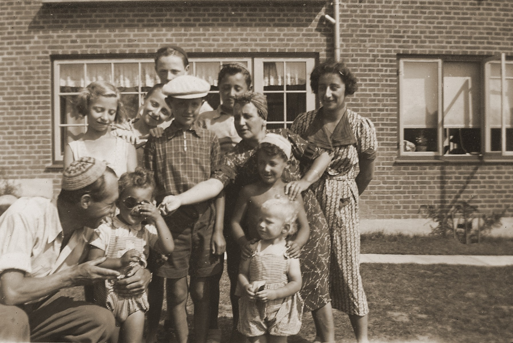 Jewish families vacation together in Denmark.  Among those pictured are Milan, Leo and Gus Goldberger and their mother Helen Goldberger.