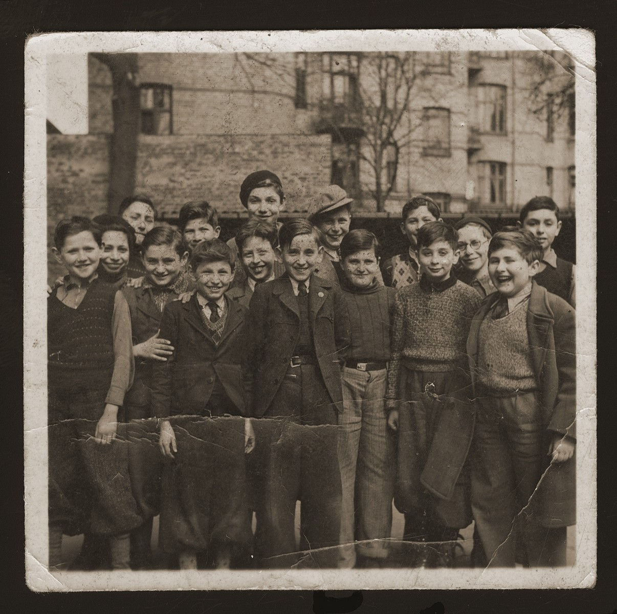 Boys from the Mosaisk Drengeskole (Mosaic Boys School).    Among those pictured are Artur Arnheim (front row, left), Raphael Sampolinsky (second from left), Bent Melchior, grandson of chief rabbi (fifth from left), Manfred Hildershein (back row center), Siegried Vogel (third from right).   The Mosaic School for Boys and the Caroline School for Girls were established in the beginning of the nineteenth century for the purpose of acculturating the children of Russian Jewish immigrants into Danish culture.  Though most of the teachers were not Jewish, the school also taught Jewish history and religion.