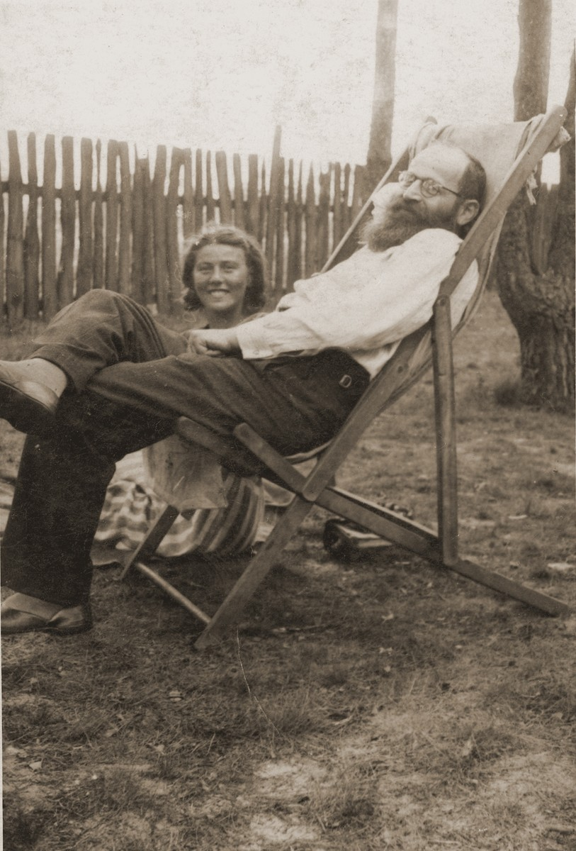 Ita Rozencwajg sits outside in the yard with her uncle Mendel Miodownik while on a visit to Minsk Mazowiecki.