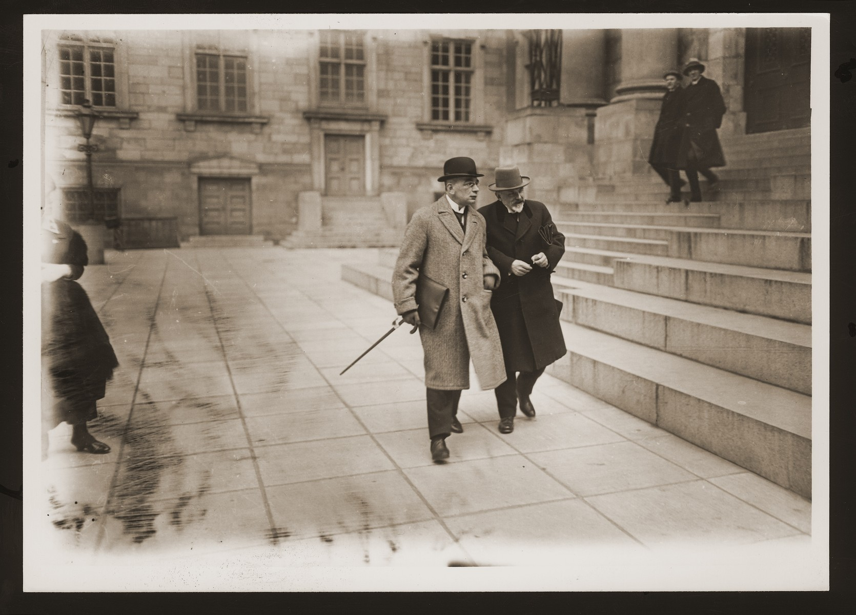Barrister Carl Bertil Henriques (left) walks outside with a colleague.