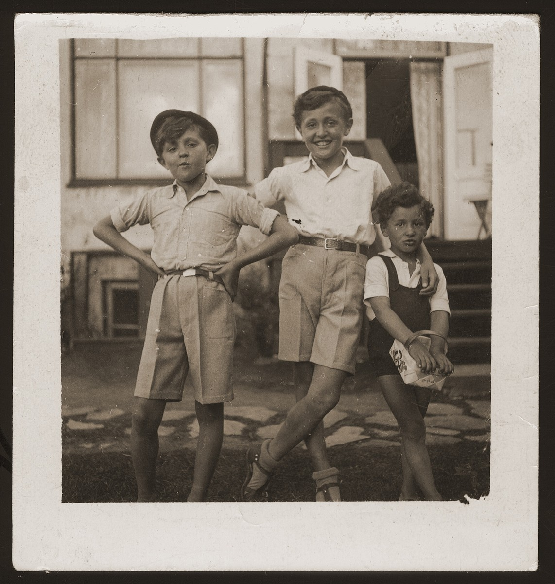 Milan, Leo and Gus Goldberger in front of their family's summer home in Rungsted.