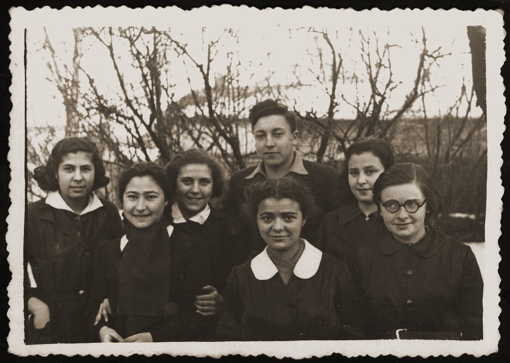 Group portrait of members of an Hashomer Hatzair Zionist youth group in Bialystok.    Among those pictured are Malka Orkin (center, front) and her friend Tusia Goldberg (third from the left).  Tusia, whose father later became a member of the Bialystok ghetto Jewish council, survived the war.