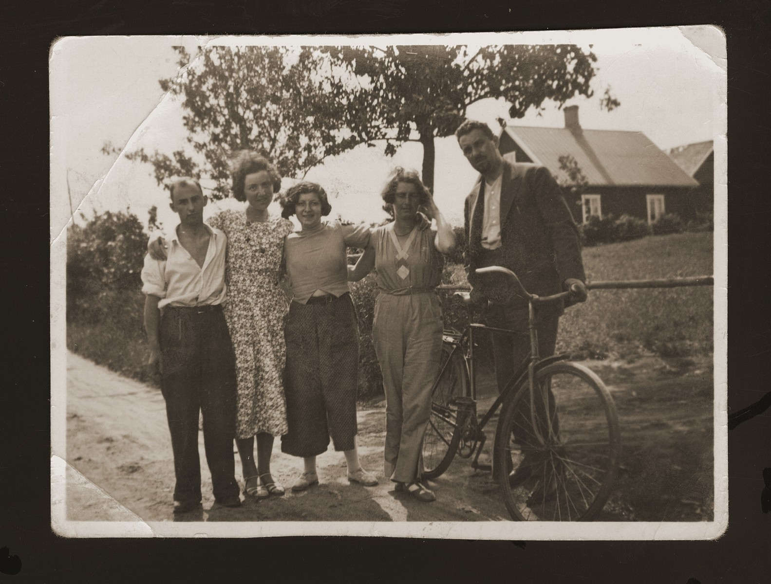 Eugene Goldberger poses with Danish acquaintances shortly after moving to Copenhagen.