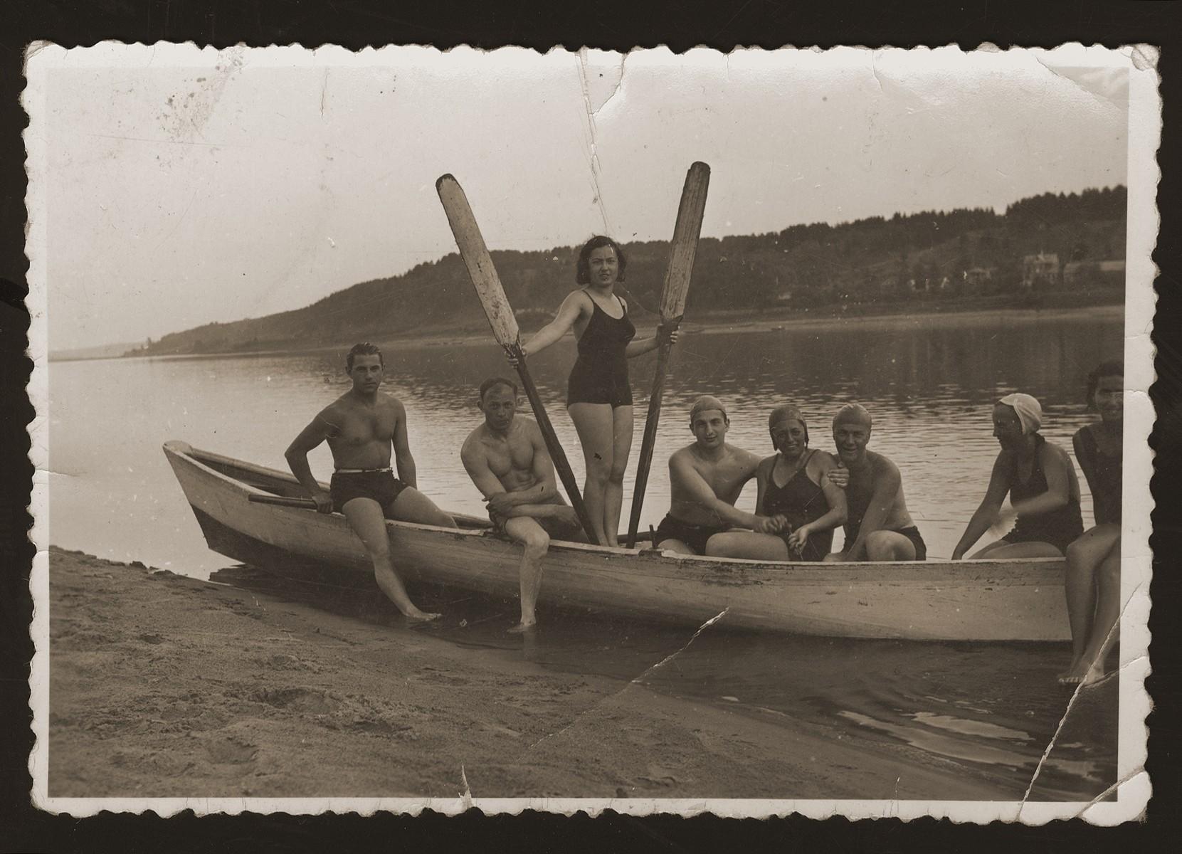 Friends boating on the Nemunas River in the village of Katcherine near Kaunas.    Pictured from left to right are Yehuda Zupovitz, Hirsh Kadushin (George Kadish), Liolia Bermann, unidentified, Riva Levi, Jasha Langleben, Polia Cukermann, and Dita Katz.