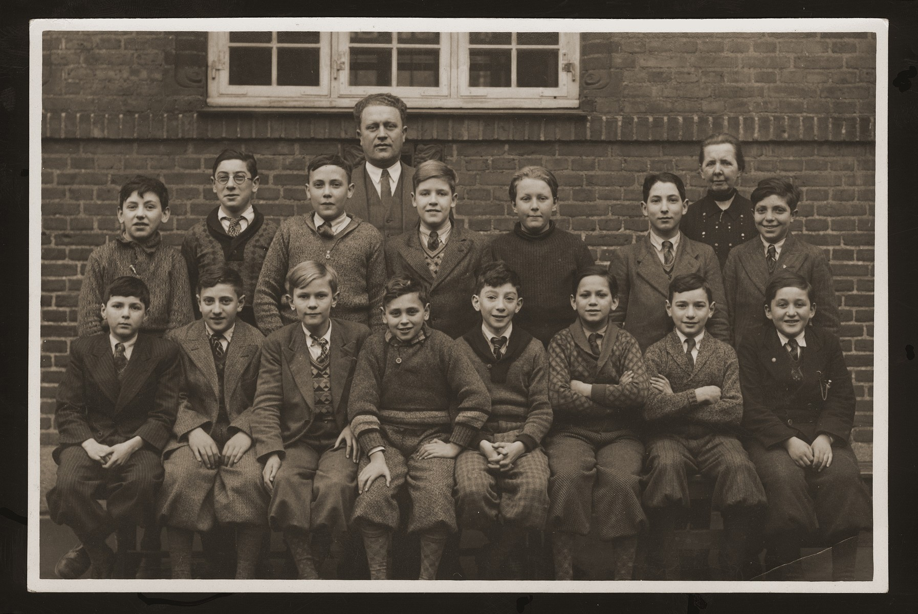 Class of the Mosaik Boys School in Copenhagen.  Seated front row, second from right is Jula (Julius) Rosenbaum.  Standing in the back is the principal, Harry Pihler.  The Mosaik School for Boys and the Caroline School for Girls were established in the beginning of the nineteenth century for the purpose of acculturating the children of Russian Jewish immigrants into Danish culture.  Though most of the teachers were not Jewish, the school also taught Jewish history and religion.