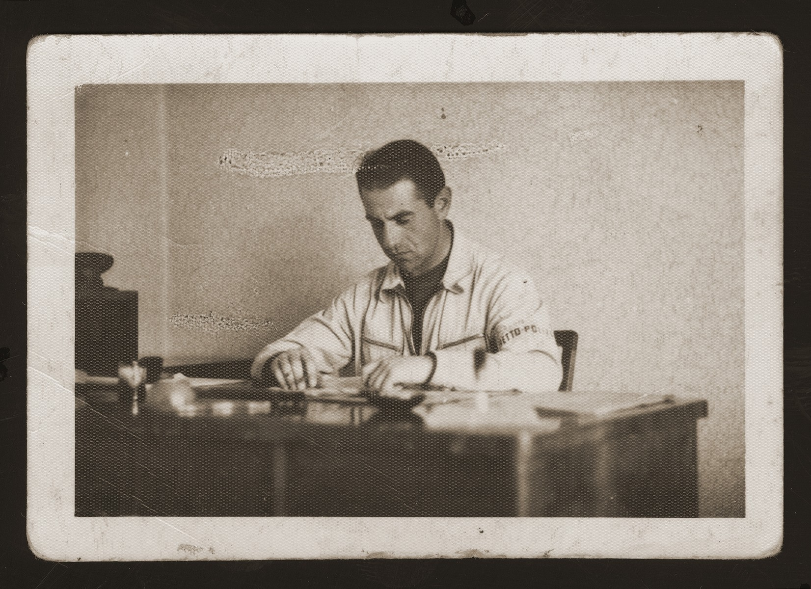 Deputy Police Chief Yehuda Zupovitz at his desk in the Kovno ghetto.