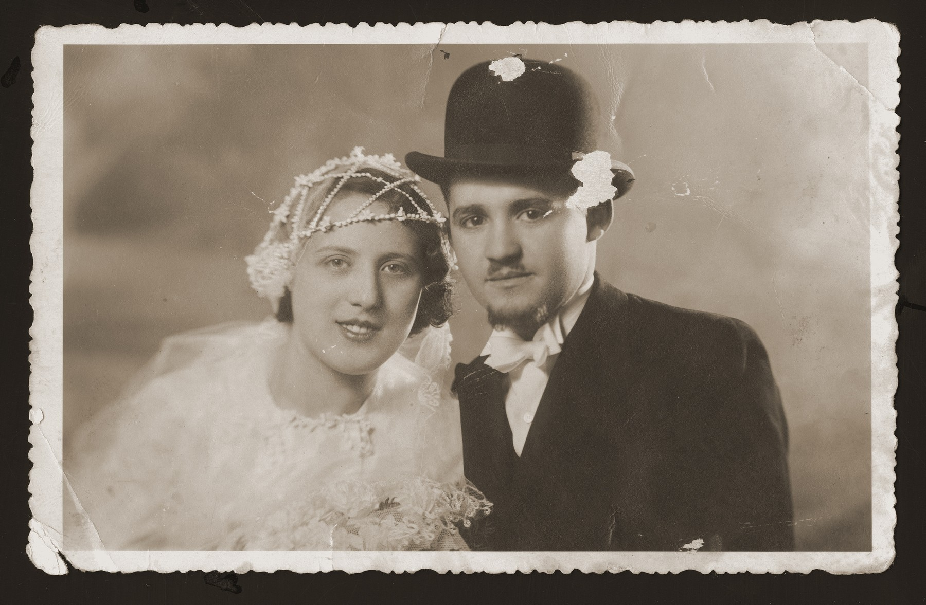 Wedding portrait of Gabor and Tubi (Goldstein) Berkovic.   He served as a cantor, originally as his brother-in-law's assistant.  Their two sons, Emil and Eddie, both became cantors as well. The family survived the Holocaust hiding in a farm near Senica.