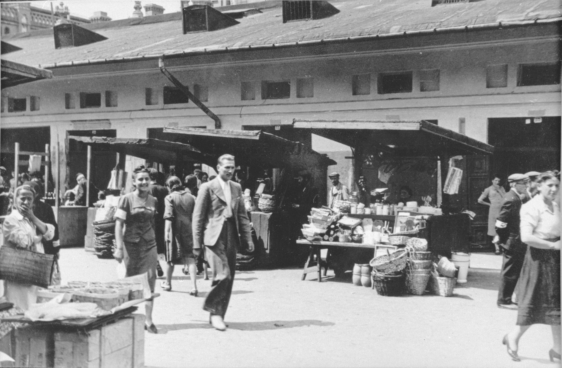 Jews and Poles shop in the Kercelak second-hand market between the Krochmalna and Mirowski squares in Warsaw.