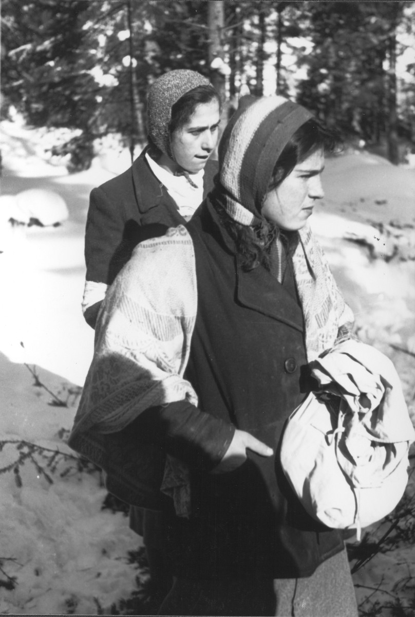 Local Jewish women, one wearing an armband, photographed by Jewish conscripts in the Hungarian Labor Service.
