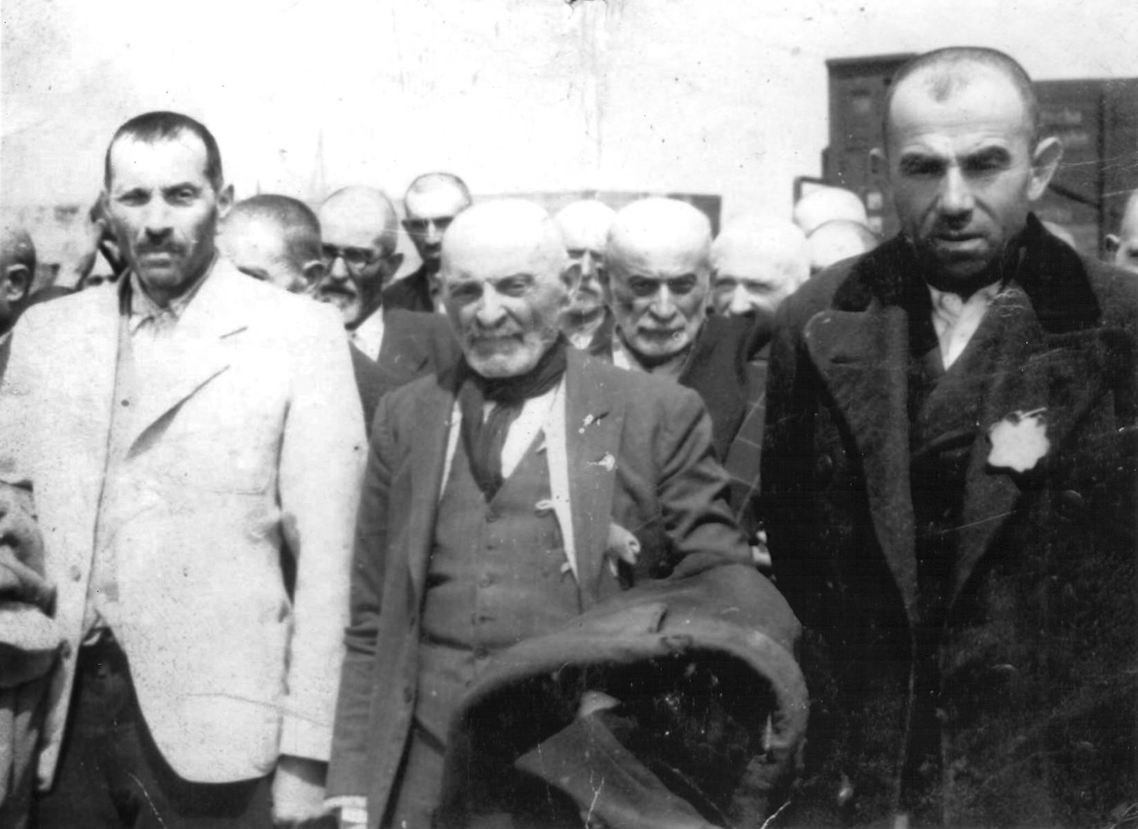 Jews from Subcarpathian Rus await selection on the ramp at Auschwitz-Birkenau.