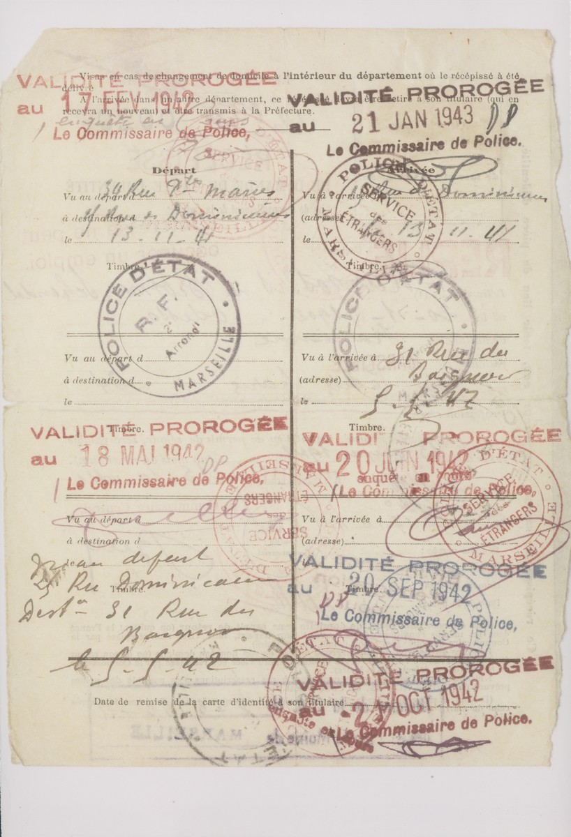 Verso of an identification card for Schendel Margosis issued by the Marseilles police stating that she is a Persian citizen and not permitted to work.  The card was stamped by the police at regular intervals.