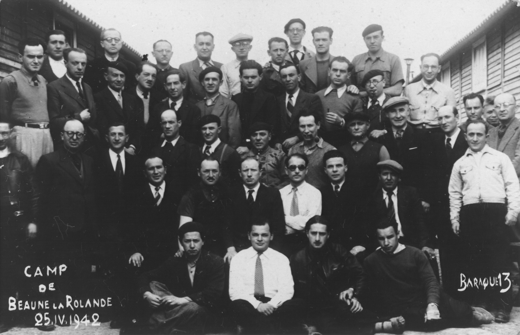 Group portrait of prisoners from barracks #13 in the Beaune-la-Rolande internment camp.  Albert Sztern is pictured on the bottom left.