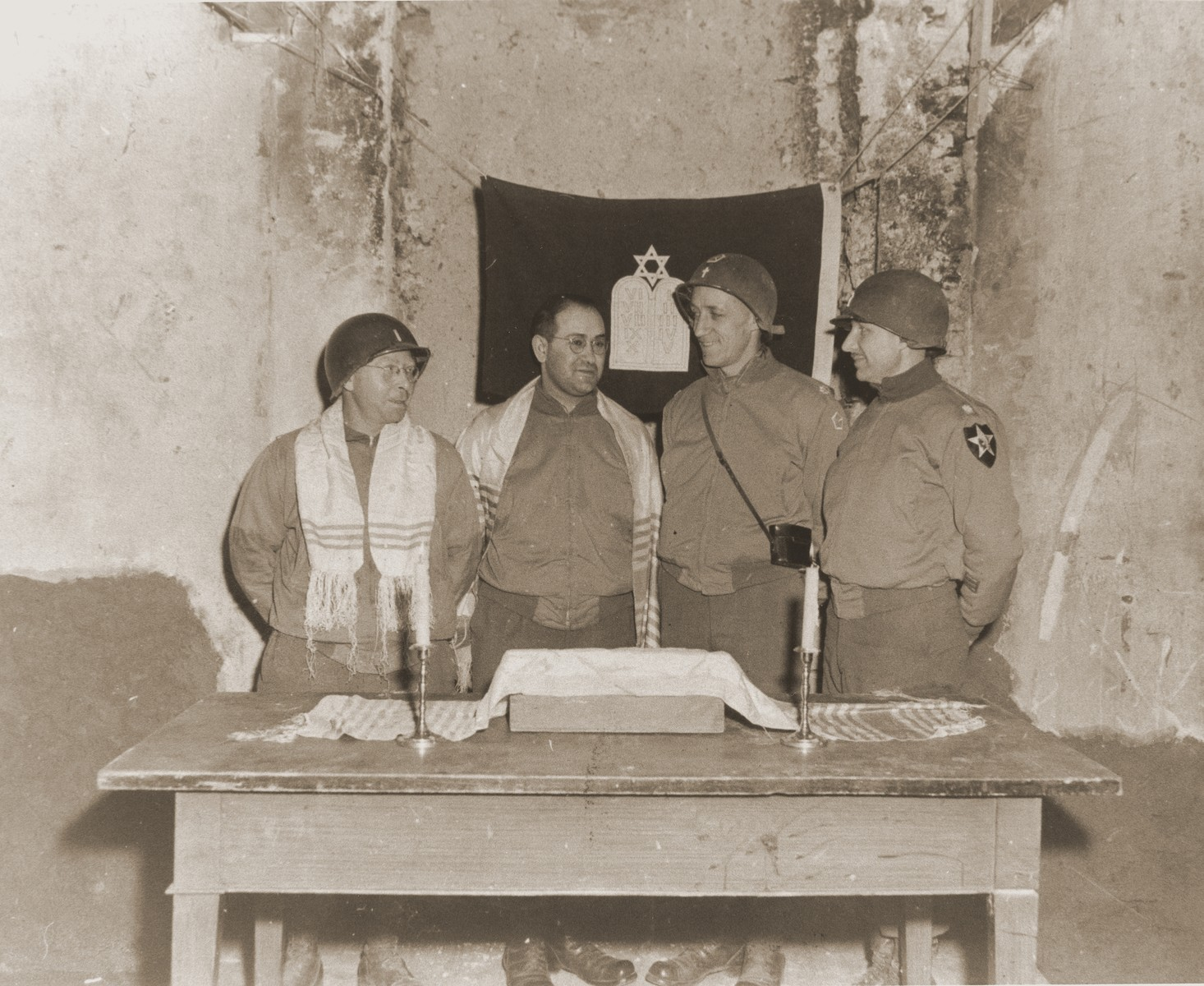 Chaplain Samson Goldstein conducts services in the partially restored Arnweiler synagogue, which was desecrated by Nazis in 1938.