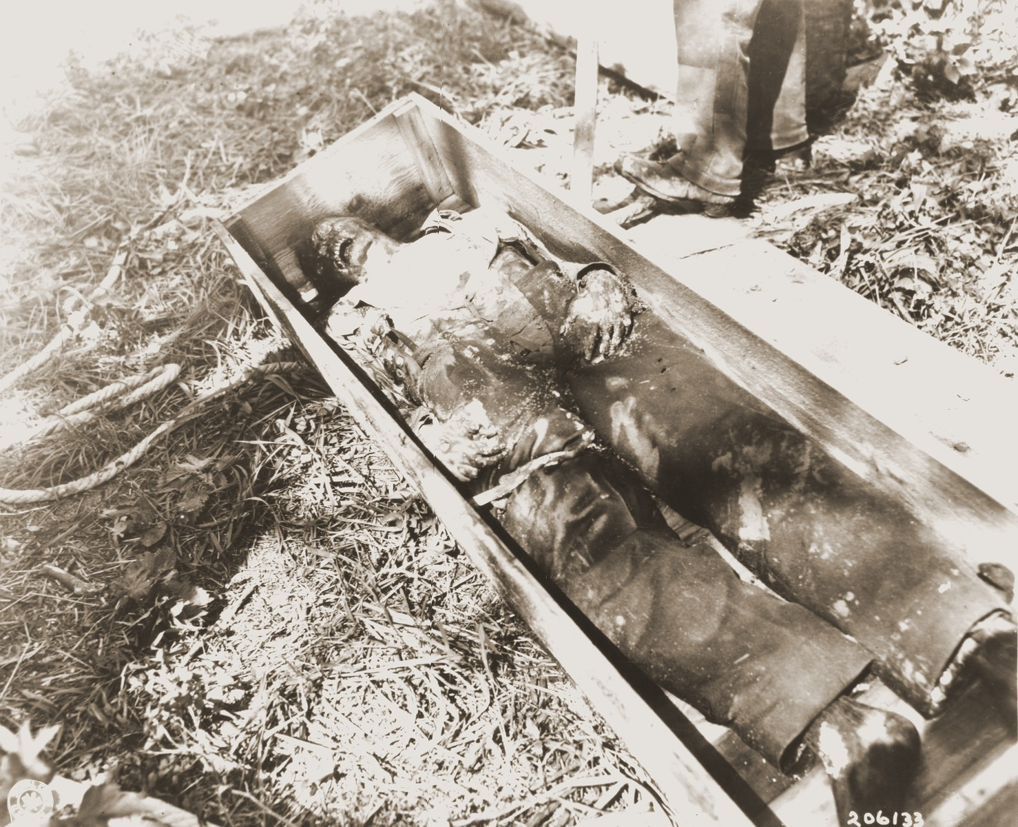 The body of a U.S. pilot who was shot by German police, along with two other American airmen, in the town of Lochtum.    After their crash landing, all three pilots were captured by local police and marched through Lochtum, where they were stoned by the inhabitants.  The pilots were then executed and their bodies buried in anonymous graves without dog tags or other identification.