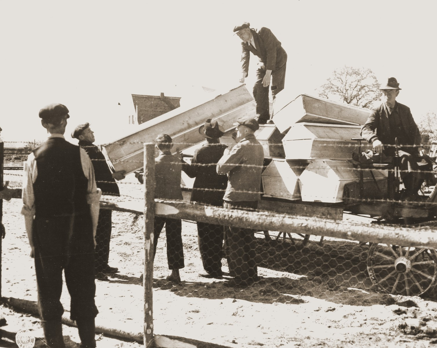 German civilians from Schwarzenfeld load a wagon with coffins to be transported to a mass grave from which the bodies of 140 Hungarian, Polish, and Russian Jews were exhumed.    The victims died while on an evacuation transport from the Flossenbuerg concentration camp.