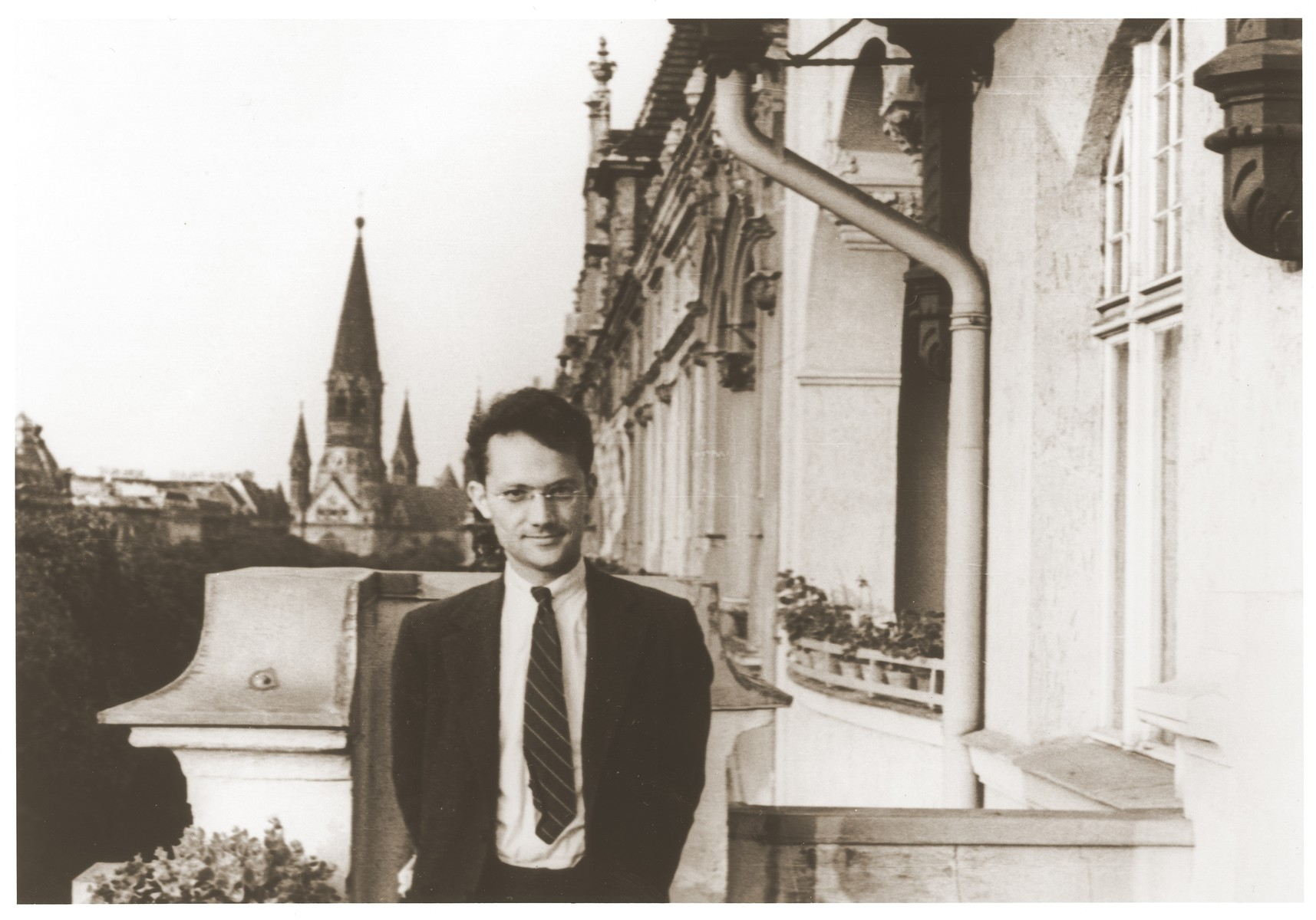 "Varian Fry poses on a balcony in Berlin, where he traveled in 1935 while serving as editor of ""The Living Age."""