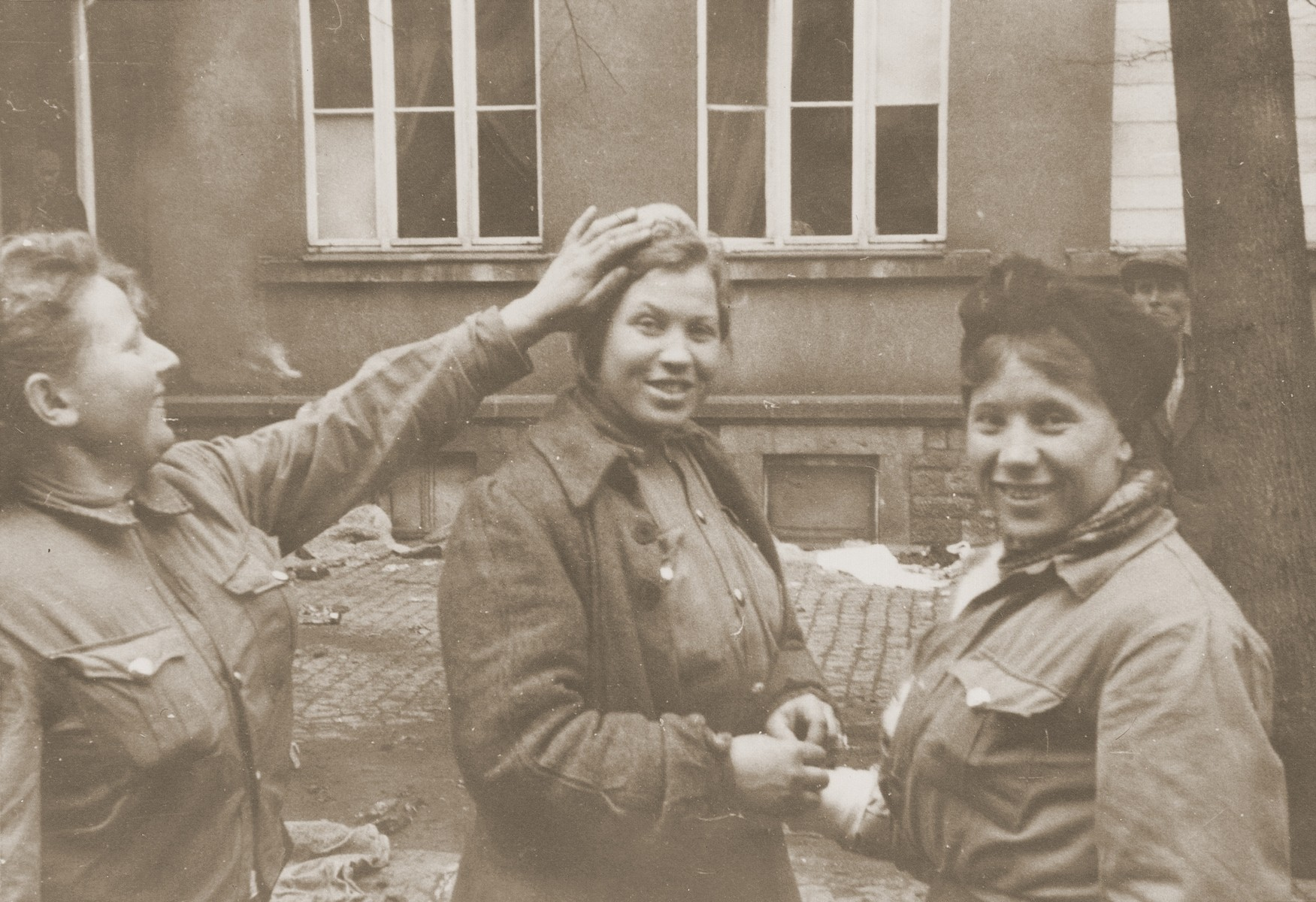 Three female DPs in Dillenburg after the liberation of the area by U.S. troops.