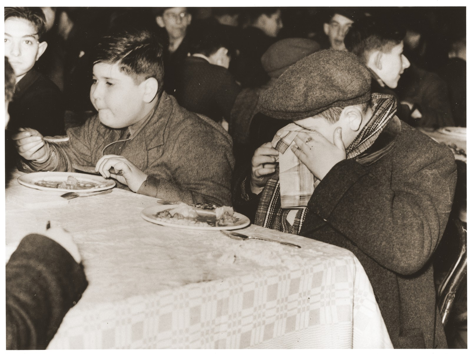 Austrian refugee children who arrived in England with the second Kindertransport, eat a meal at the Pakefield holiday camp in Suffolk.