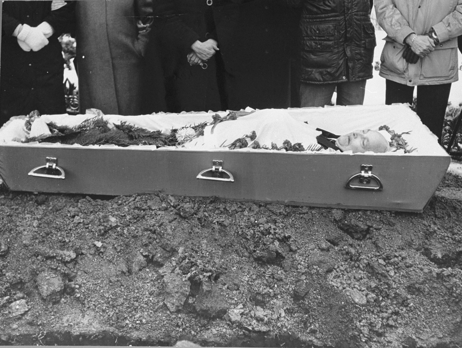 The body of Lt. Aleksander Pechersky lies in an open coffin during his funeral.