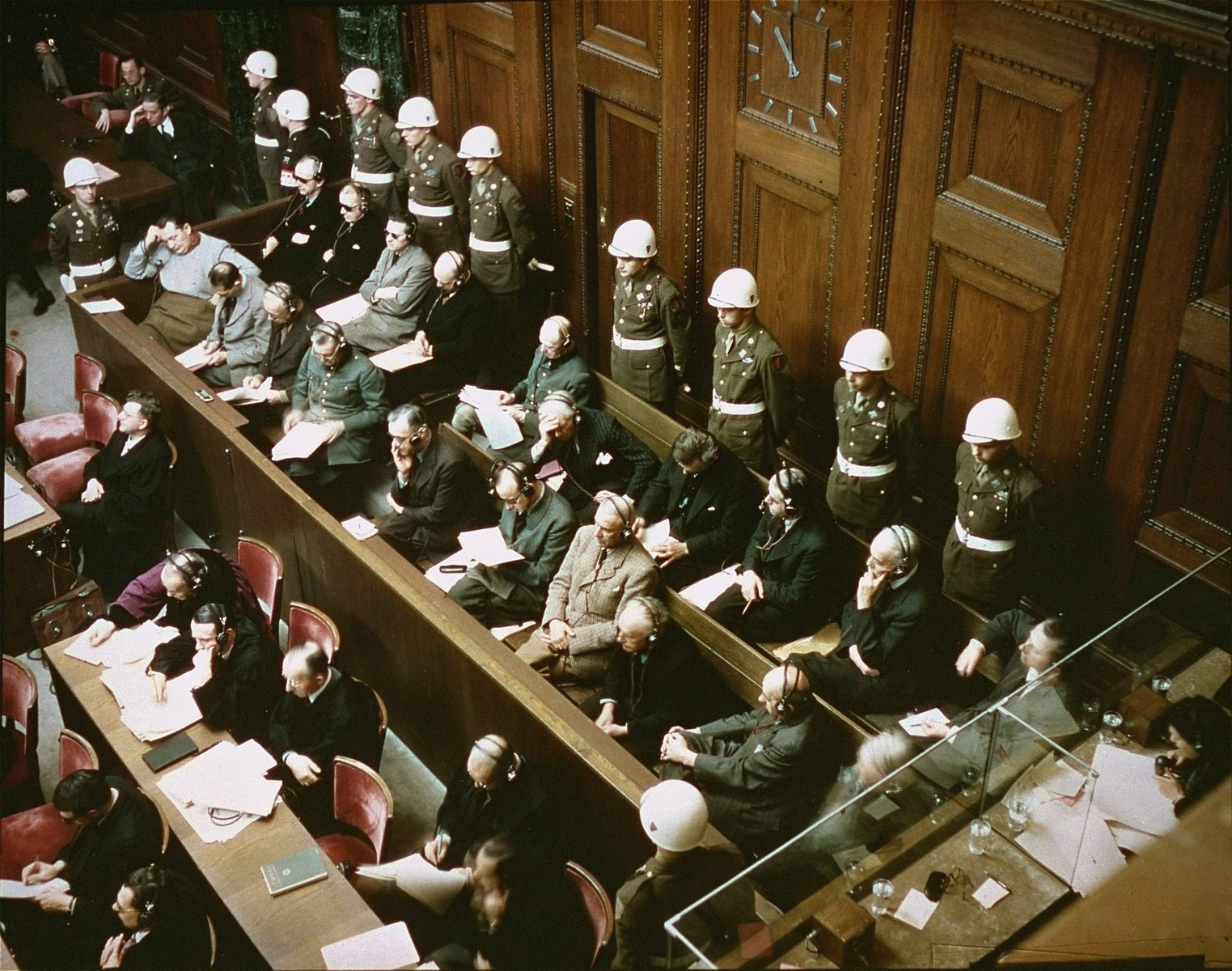 View of the defendants in the dock at the International Military Tribunal trial of war criminals at Nuremberg.  Among those pictured is Robert W. Gilbert, who was a guard with the 18th Regiment.