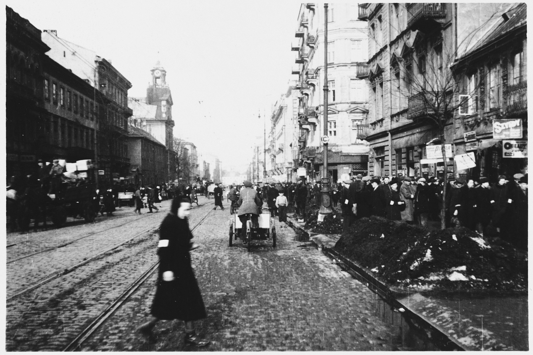 Jews walk along a crowded street in the Warsaw ghetto.