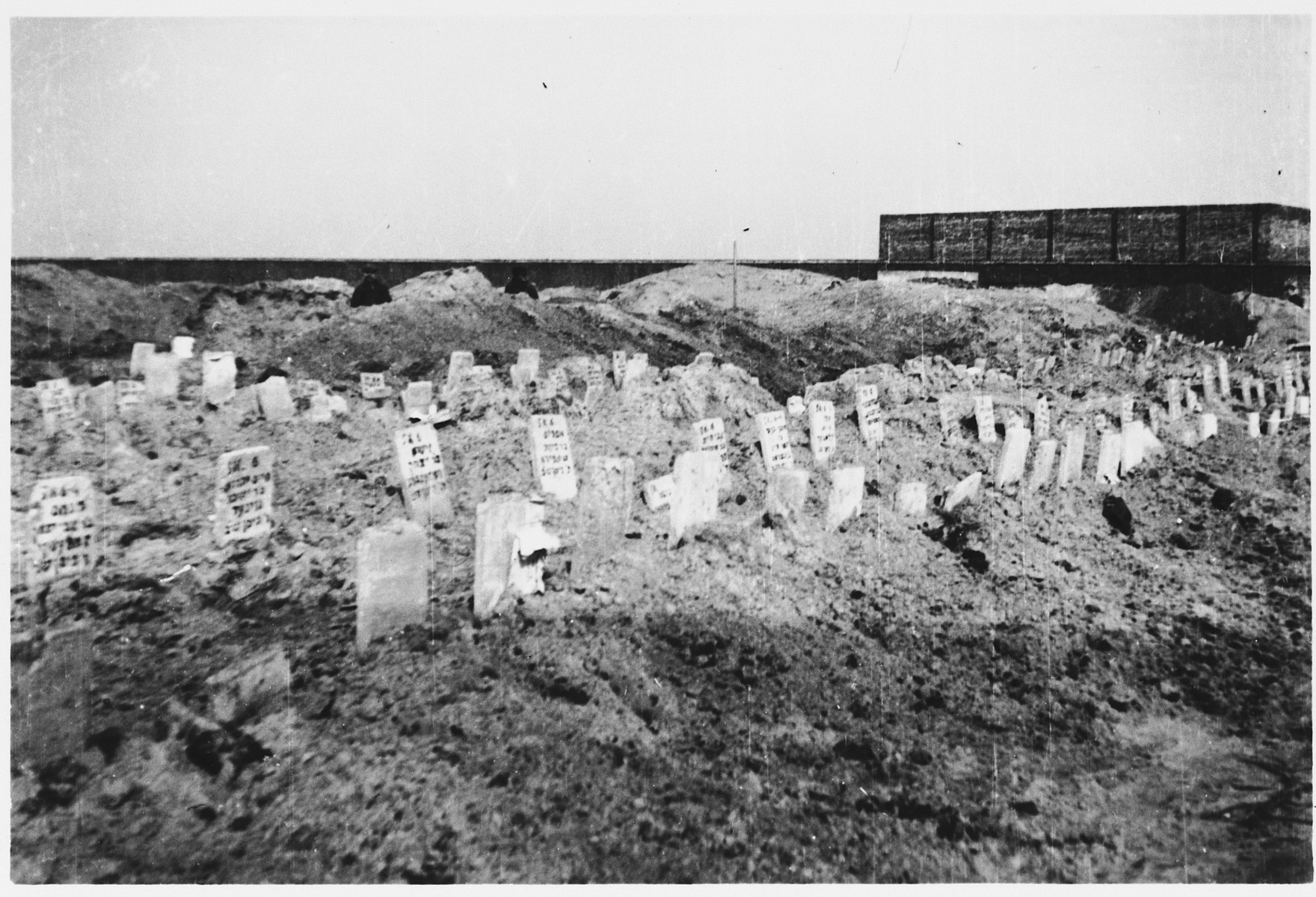 Makeshift tombstones mark the mass grave of Jewish victims in the Warsaw ghetto.