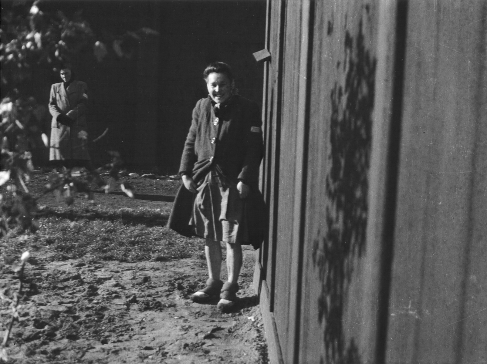 Clandestine photograph of a Polish political prisoner and medical experimentation victim in the Ravensbrueck concentration camp.  Pictured is Barbara Pietrzyk.  Her prisoner number is visible on the sleeve of her coat.  Maria Kusmierczuk is standing in the back.