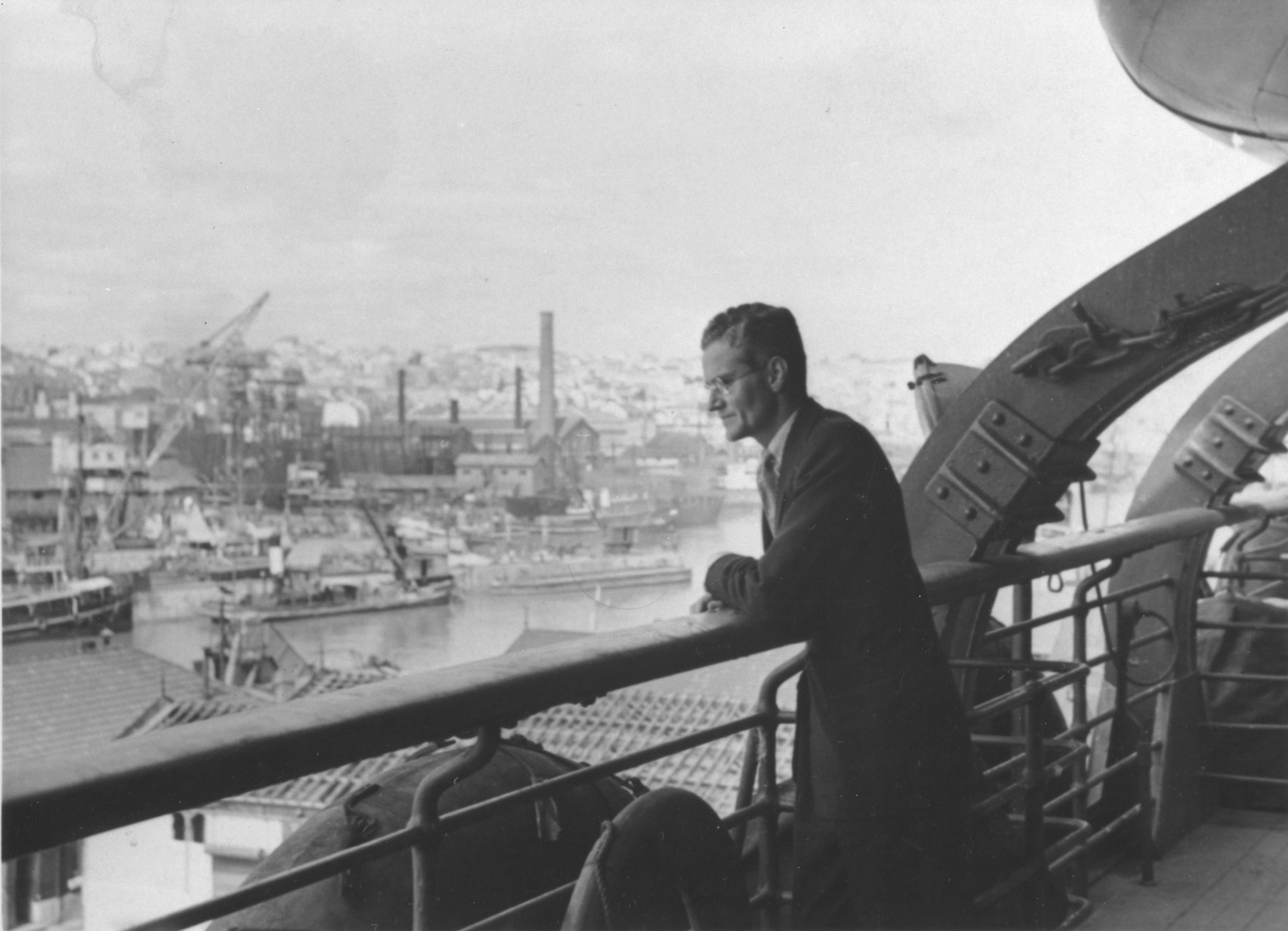 Standing on a bridge, American Vice Consul Hiram Bingham looks out over the port of Marseilles.