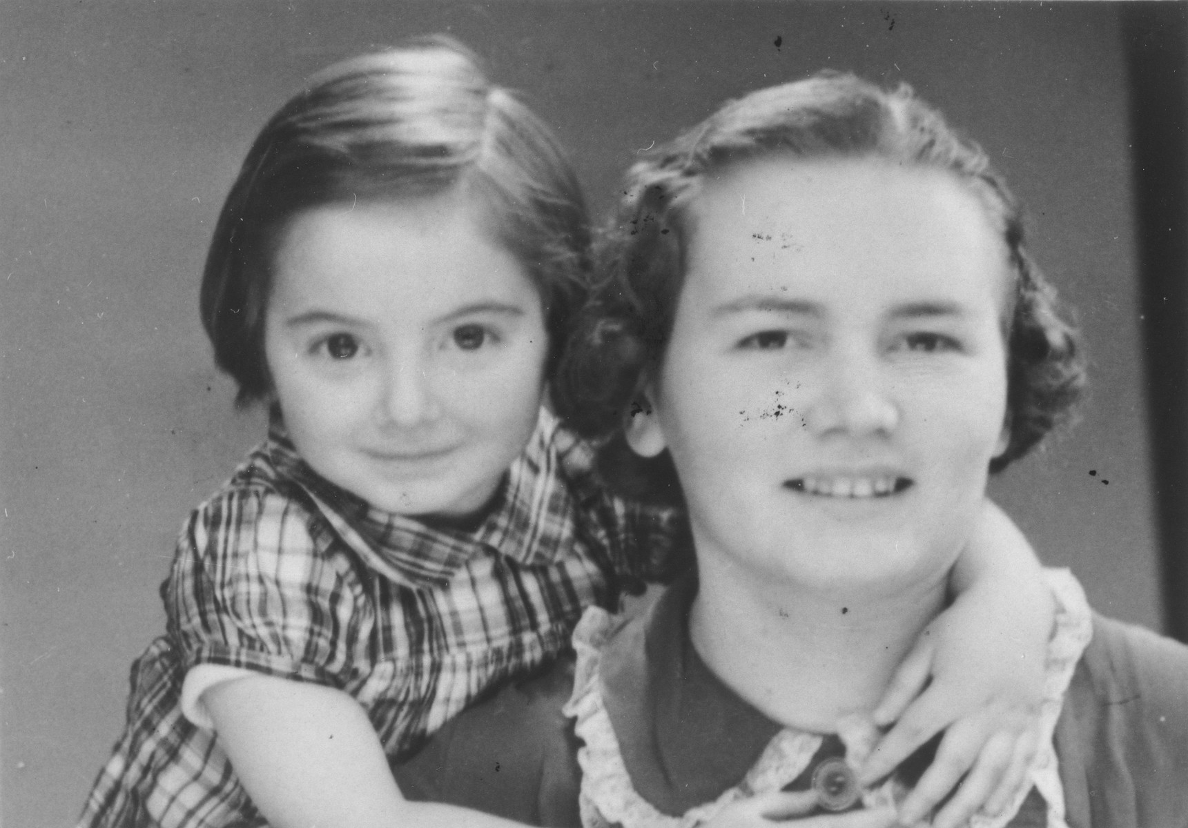 Portrait of a Jewish mother and child in Paris.  Pictured is Catherine Gotteszmann with her arms around her mother Helene.