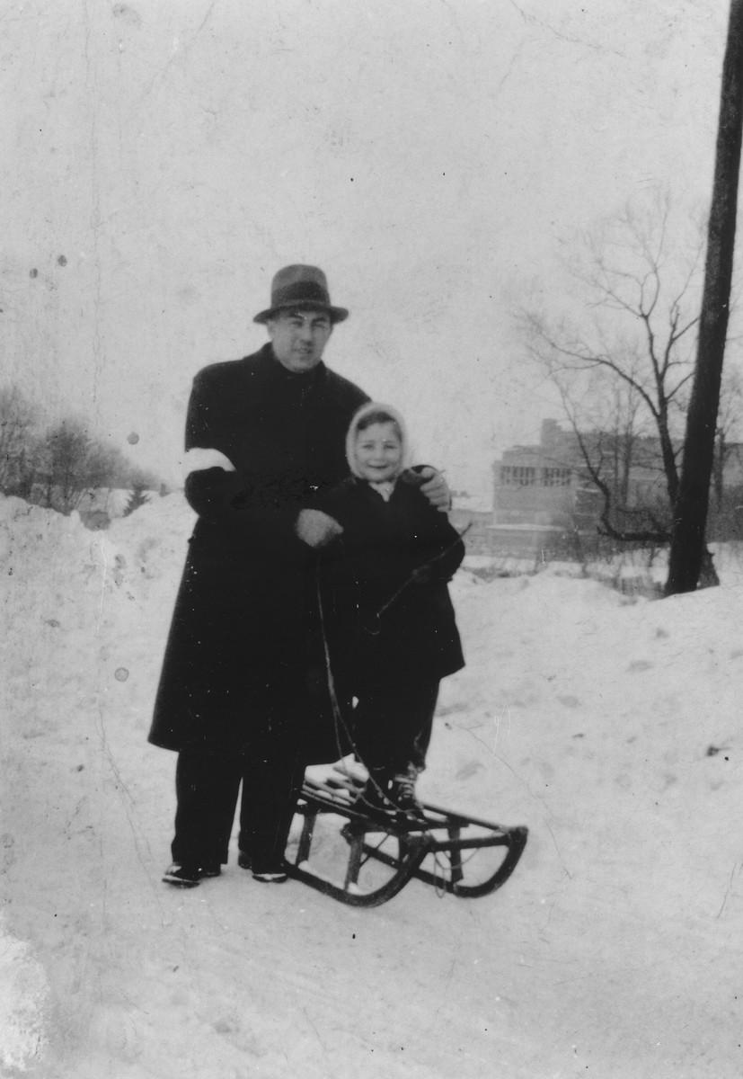 Salo Haar takes his son Roman sledding in the Rzeszow ghetto.