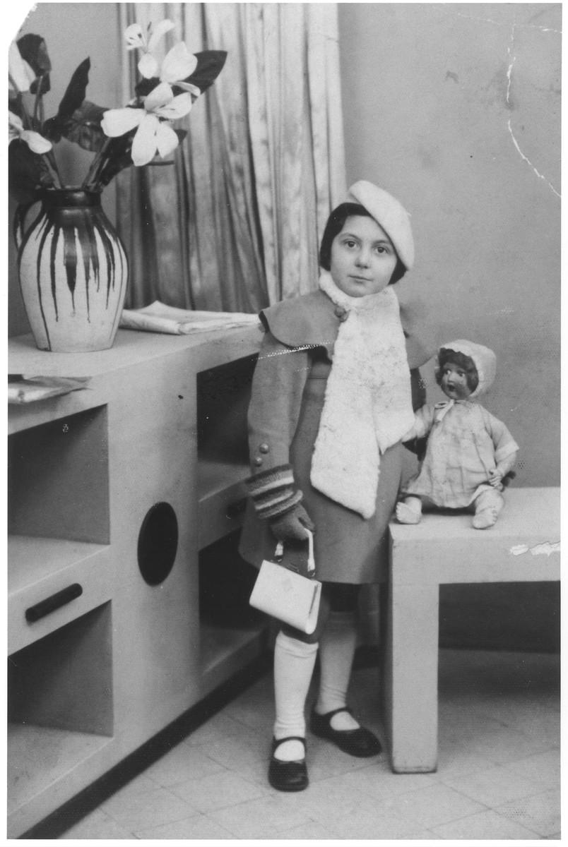 Studio portrait of five-year-old Rachel Kokotek with a doll.