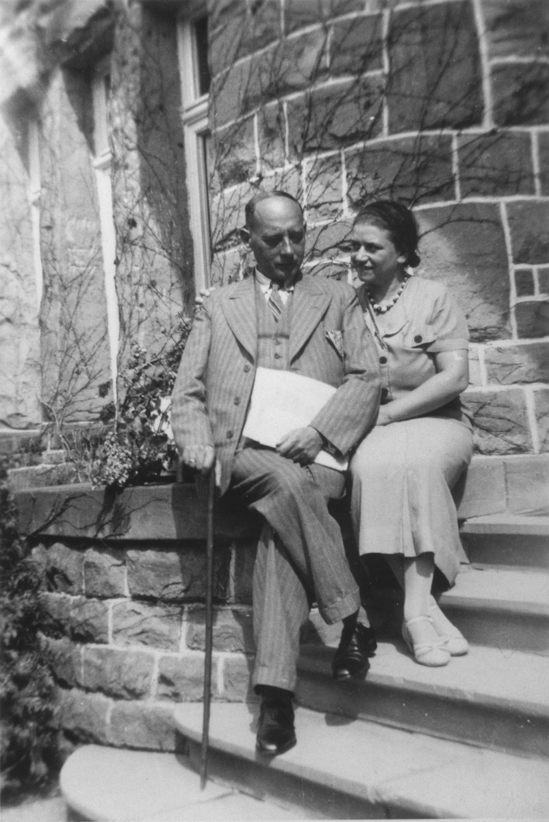 Eugen and Nanette Wassermann sit on the steps of a building in Nuremberg.